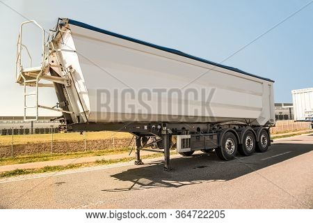 Trailer Waits For Cargo Loading. Delivery Of Goods By Truck
