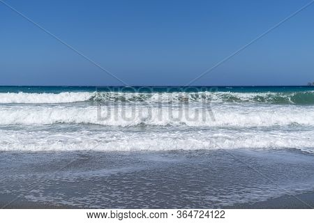 Waves On The Sea With Blue Sky