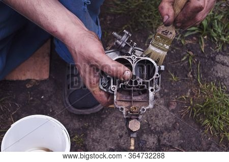 Carburetor Of The Internal Combustion Engine Of A Vaz 2106. Automobile Parts And Spare Parts.