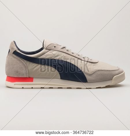 Vienna, Austria - May 27, 2018: Puma Jogger Og Grey And Navy Blue Sneaker On White Background.