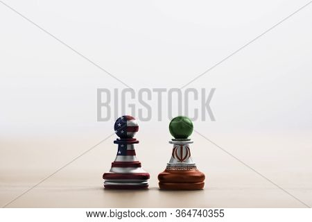 Usa Flag And Iran Flag Print Screen On Pawn Chess With Soft Light Background.it Is Symbol Of United
