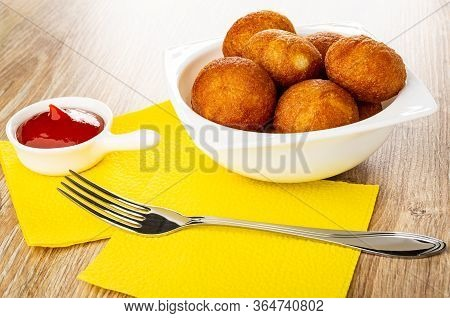 White Sauceboat With Ketchup And Fork On Yellow Paper Napkins, Bowl With Small Round Fried Pies On W
