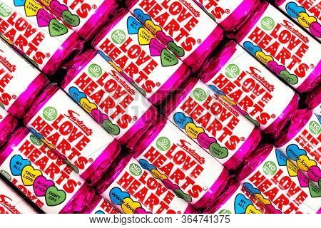 Southampton, UK - 3rd May 2020:  background of Swizzels Love Hearts. This popular childhood fizzy sweet is a hard candies embossed with love messages and has been in production for nearly 70 years