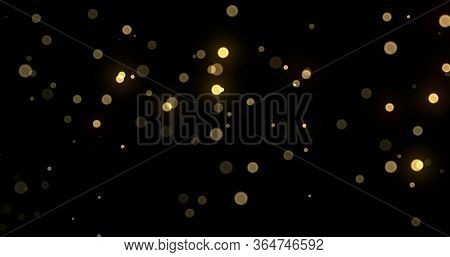 Light bokeh gold shine glitter background, abstract blur. Golden yellow glitter particle flares effect. Bright glowing shiny light bokeh sparkles on black background