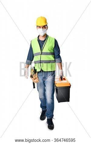Manual worker goes to work despite of Coronavirus epidemic isolated on white background.