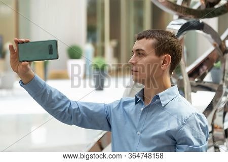 A Man Is Testing The Camera On The Phone. The Buyer Is Trying The Video And Photo Mode On His New Sm