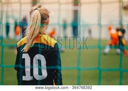 Soccer Girl Playing Game As A Goalie. Youth Female Football Team Playing Tournament Match