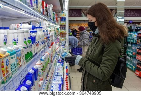 Minsk, Belarus - April 27, 2020: Man In Protective Mask Shopping Milk In Grocery Store During Corona