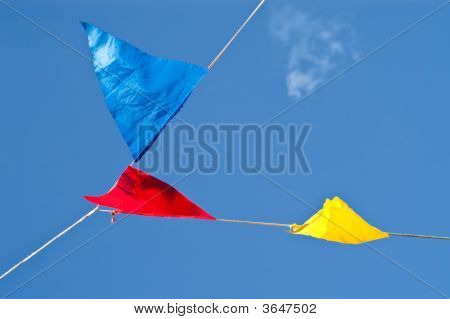 Colourful Signal Flags Hanging On A Wire