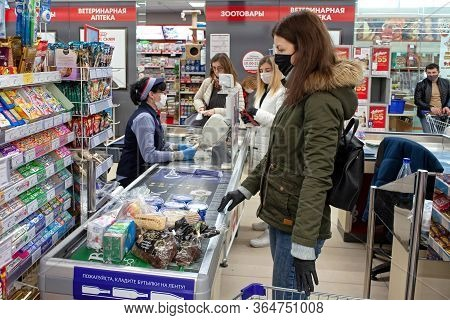 Minsk, Belarus - April 27, 2020: Customers And Grocery Store Workers In Medical Masks And Gloves To