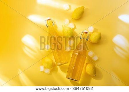 Homemade Lemonade Concept, Top-down View Of Freshly Made And Bottled Chilling Lemon Drink