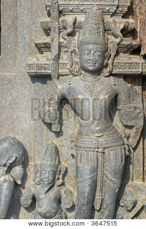 Statue of Hindu God at the ancient Surya Hindu Temple at Konark Orissa India. 13th Century AD poster