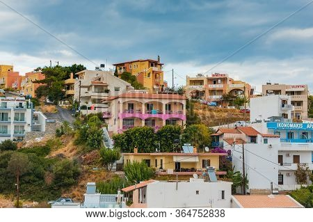 Bali, Crete, Greece - October 7, 2019: Colorful Buildings Of Small Hotels And Apartments On The Moun