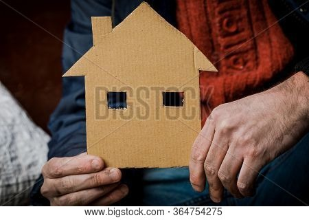 A Homeless Person Holds A Sign , Asks For Work, And Seeks Help. The Concept Of Poverty And Homelessn