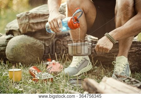 Man Traveler Hands Holding A Cup Of Tea Outdoors. The Concept Of Adventure, Travel, Tourism And Camp