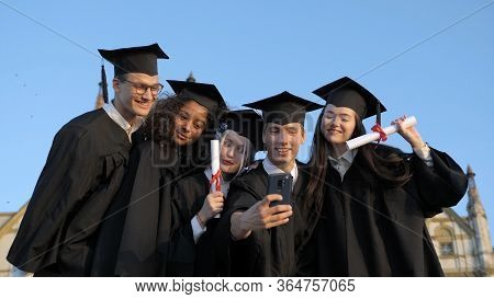 Multi Ethnic Group Of Graduated Students Taking Selfie.