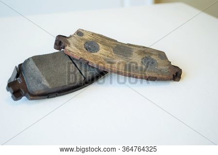 Worn Out Ruined Disc Brake Pad Compared To One That Is New