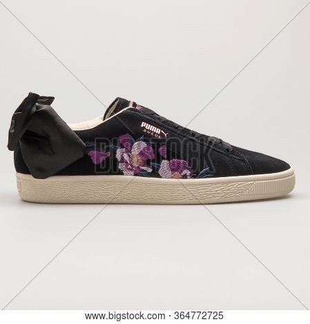 Vienna, Austria - May 27, 2018: Puma Suede Bow Flowery Black, Rose Gold And Purple Sneaker On White