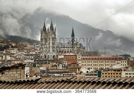View of Quito, capital of Ecuador with the basilica being prominent, gloomy mist