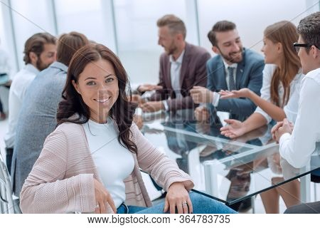 young business woman sitting at corporate business team meeting .