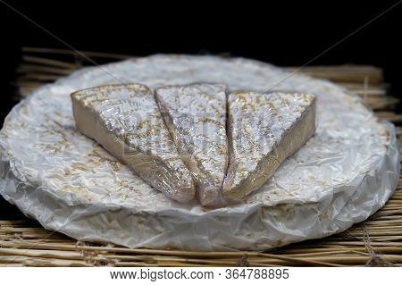Cheese Brie. Cheese Brie With Triangle Pieces Out Placed On Top. Round Soft Cheese Brie.