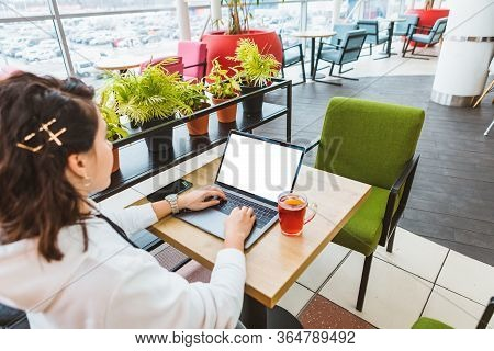 Woman Working On Laptop In Cafe White Screen Freelancer Concept Drinking Hot Fruit Tea