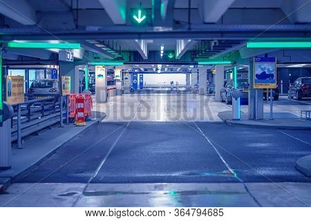 Exit From Underground Parking. Underground Parking Garage. Barrier At Entrance And Exit Of A Car Par