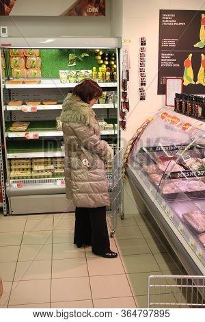 Belgrade, Serbia: June 2, 2019: Woman In Decision To Buy Food In Super Market In Belgrade Mega Store