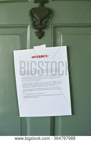 Sign Reading Overdue Is Taped To A Front Door - Late Bills - Rent - Mortgage - Loan