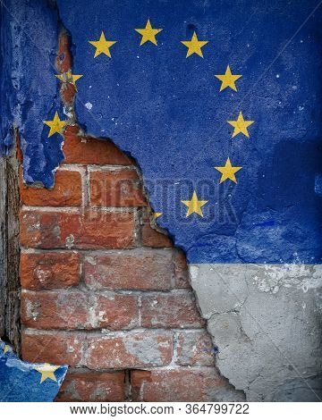 Eurozone Problems. Eu Flag Painted On The Wall With Which The Plaster Crumbles, Revealing The Old Br