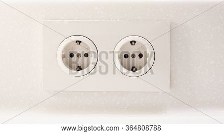 White double electric outlet on the wall