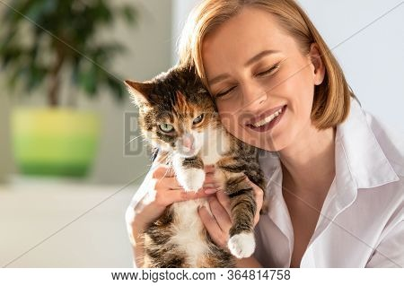 Close Up Of Smiling Woman In White Shirt Hugging And Embracing With Tenderness And Love Domestic Cat