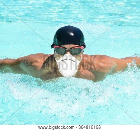 Masked man swimming in a pool, coronavirus pandemic sport concept