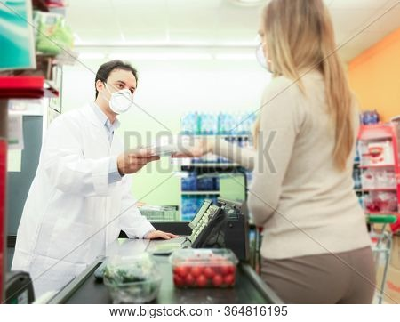 Customer and cashier in a supermarket