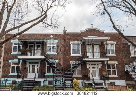 Typical North American Red Bricks Residential Houses In Autumn In Le Plateau District, One Of The We