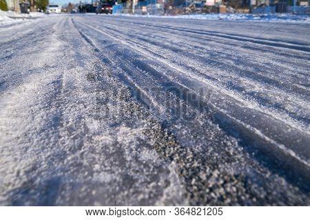 Frozen Slick Road. A Hazardous Icy, Slippery Road.