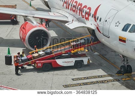 MEDELLIN, COLOMBIA - APRIL 24, 2019: Luggage of loaded to an Avianca airliner at Jose Maria Cordova Airport in Medellin. Avianca is a Colombian airline, second largest in Latin America, South America