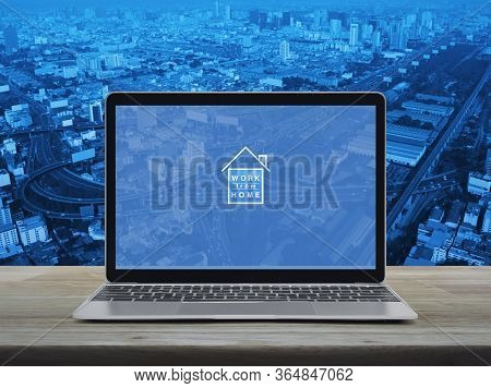Work From Home Flat Icon With Modern Laptop Computer On Wooden Table Over City Tower, Street, Expres