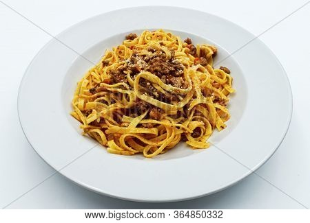 Fettuccine With Ragu Bolognese And Parmesan Isolated On White. Italian Pasta