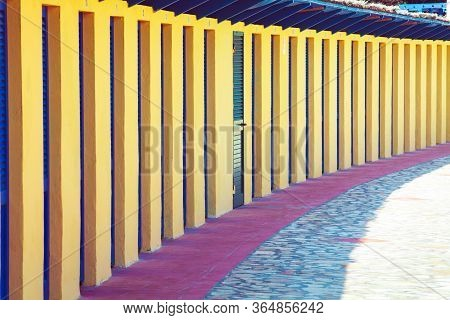 Perspective Of Repeated Cabins For Beach Holidays. Long Row Of Concrete Cabins To Allow Vacationers