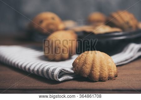 Homemade French Madeleines With Beurre Noisette On Wooden Table. Horizontal.