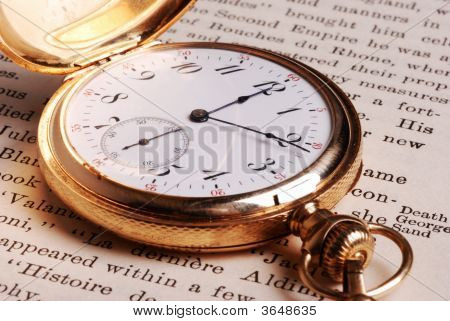 Antique Watch On Open Book