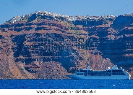 Ship Sea Trip. Santorini, Cyclades, Greece. Amazing Santorini View On White Cave Houses From The Aeg