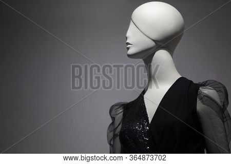 Female Mannequin On A Gray Background.woman Mannequin In Business Clothes.