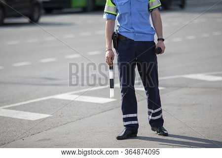 Road Inspector With A Baton.city Background Inspector With A Rod.