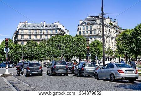 France, Paris, May, 20, 2014 - Car Traffic On The Avenues Of Paris. Champs-elysees. Paris, France
