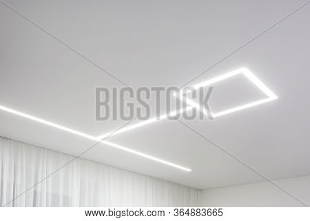 Looking Up On Suspended Ceiling With Halogen Spots Lamps And Drywall Construction In Empty Room In A