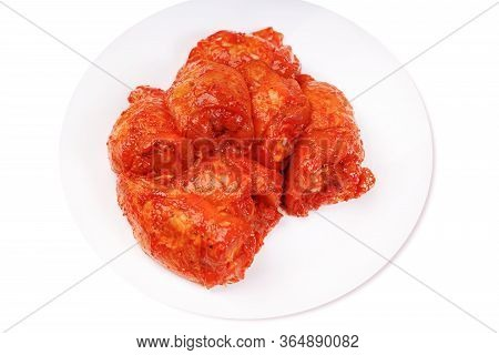Uncooked Marinated Chicken Thigh. Chicken Legs In A Red Marinade On A White Plate .isolated