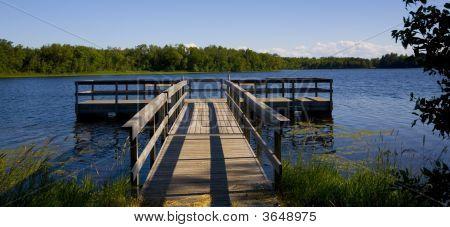 Fishing Pier In Blue Lake