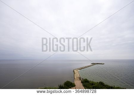 Vente Cape In Lithuania. View Of A Pier In The Sea.
